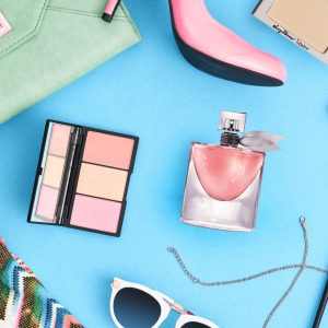 57784377 - fashion stylish clothes, cosmetics, makeup accessories. urban summer girl colorful outfit. stylish glamor heels, handbag clutch, trendy pants, necklace sunglasses. woman essentials. unusual, top view