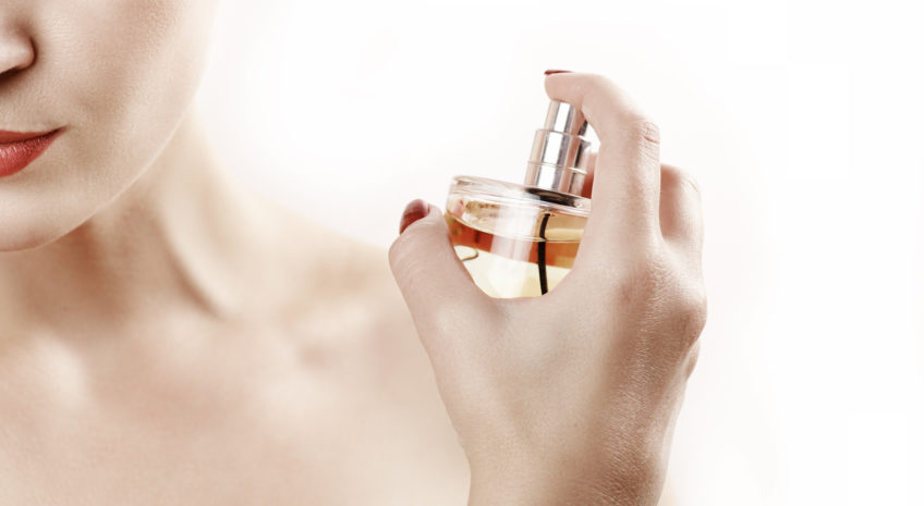 Close up beauty woman portrait with parfume against white