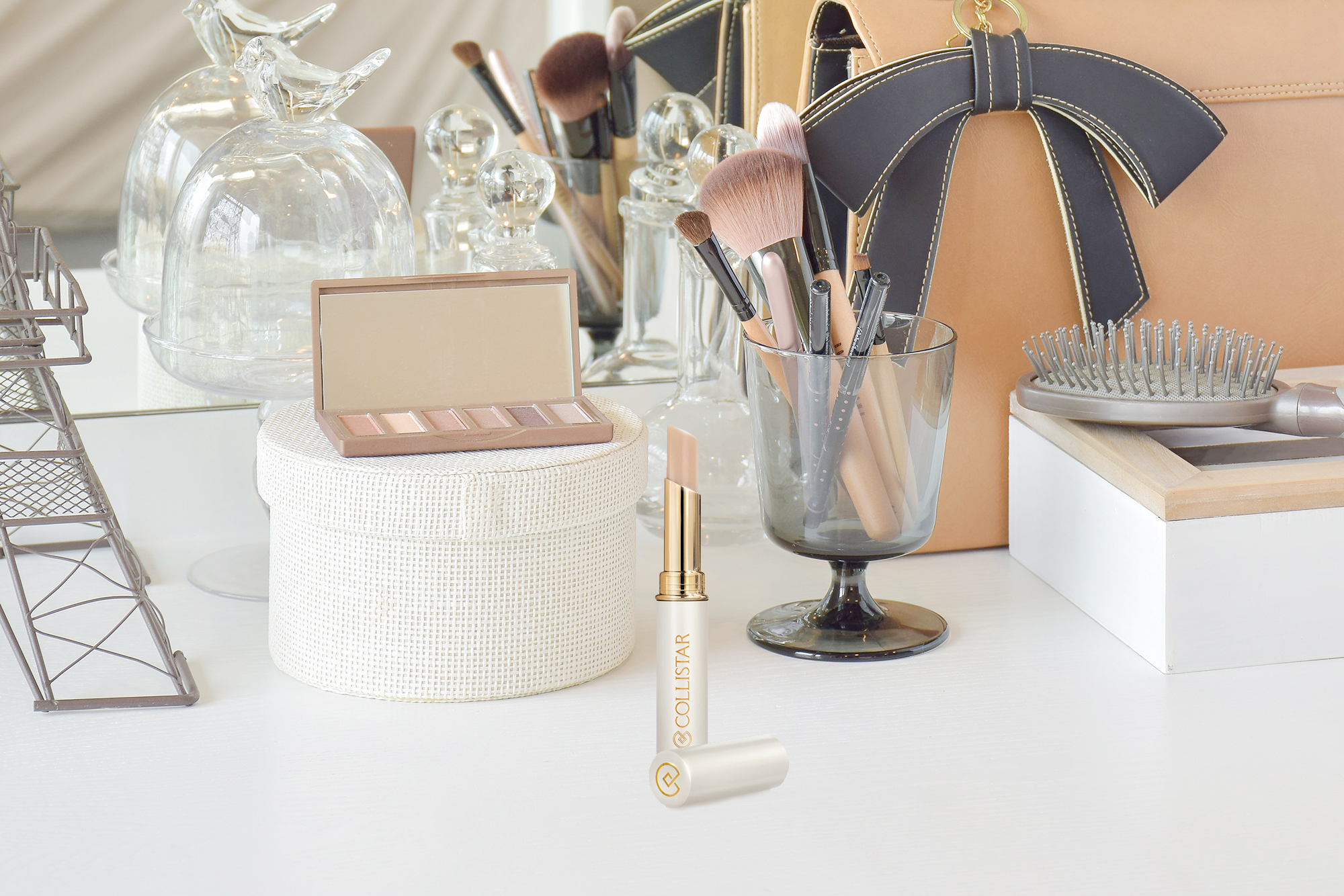 56114360 - make up items and leather bag on dressing table